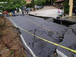 road destroyed by a huge sinkhole